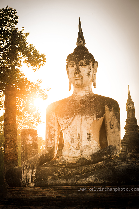 Buddha in meditation inside Sukhothai park