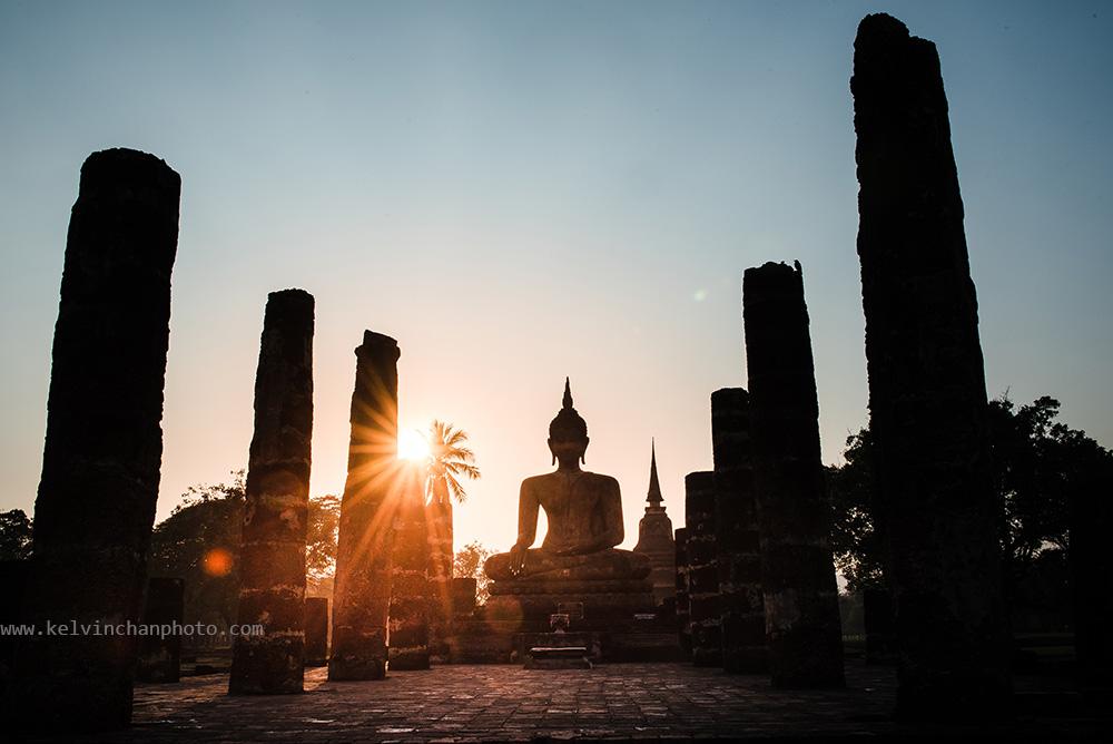 Buddha in sukhothai park duirng sunset.