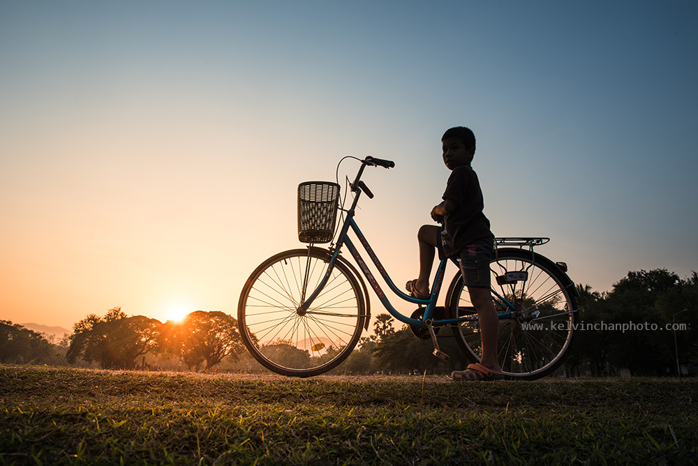 boy  with bicycle at sukhothai