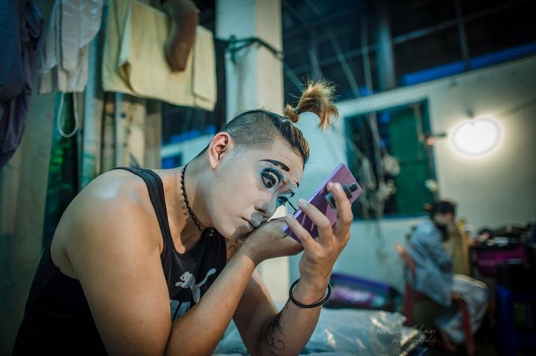 Chinese opera performer putting on make up