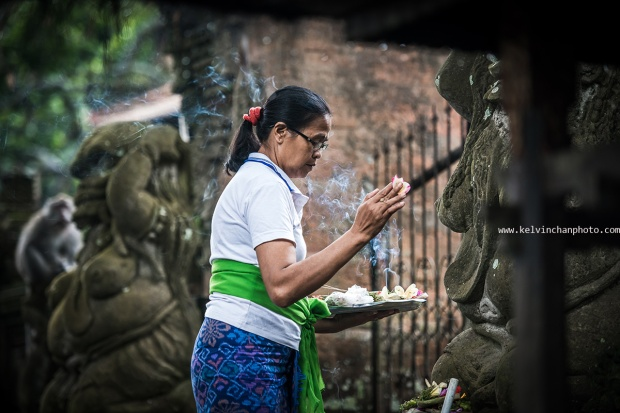 Balinese woman giving offerings in Monkey Forest Park