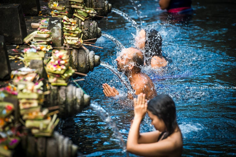 dipping in blessing pool of Purta Tirta Empul